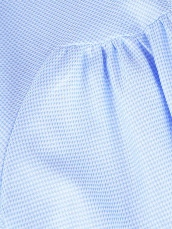 Camisa assimétrica com botões forrados